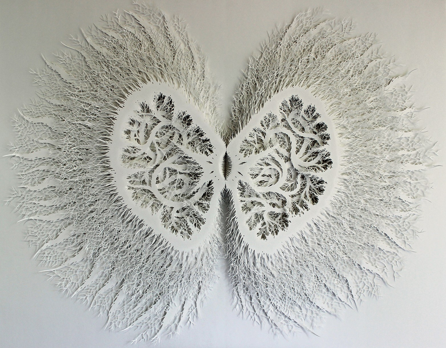 Hand cut layered paper relief sculpture